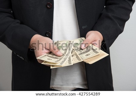 Businessman counting money american dollar.