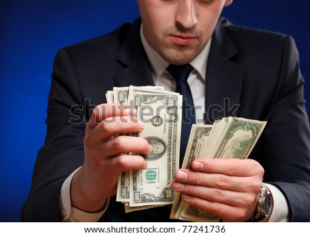 Businessman counts money - stock photo