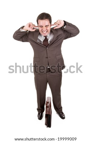 Businessman covering his ears with his fingers - stock photo