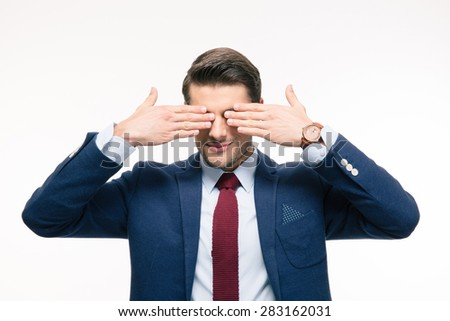 Businessman covering his eyes isolated on a white background