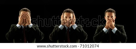Businessman covering his mouth,eyes and hears on black background. - stock photo