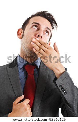Businessman covering his mouth with his hand - stock photo