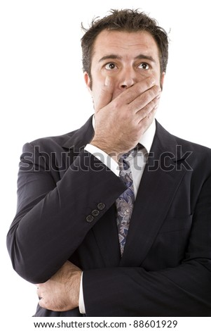 businessman covering his mouth with his hand and making an expression of surprise - stock photo
