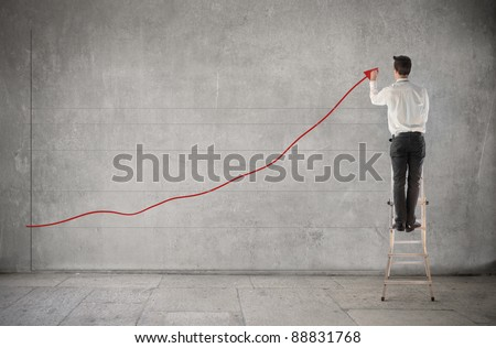 Businessman creating a chart of the earnings
