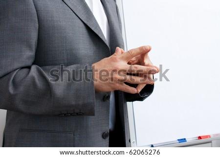 Businessman crossed hands - stock photo