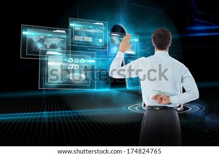 Businessman crossing fingers behind his back against keyhole on technological background - stock photo