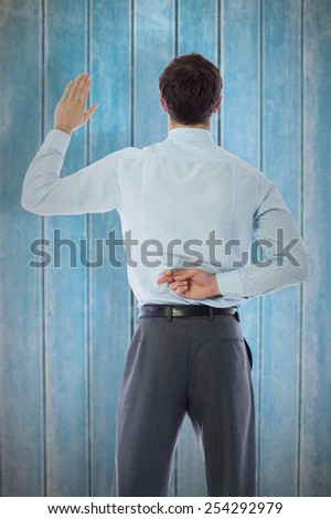 Businessman crossing fingers behind his back against wooden planks