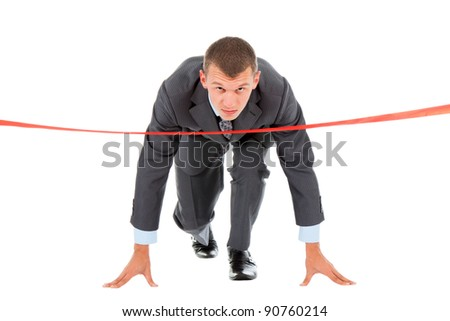 Businessman crossing finish line, wear modern suit, stand ready in start position, isolated over white background - stock photo