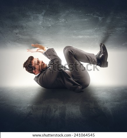 Businessman crushed by the problems and stress - stock photo