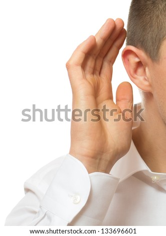 Businessman Cups his Ear - stock photo
