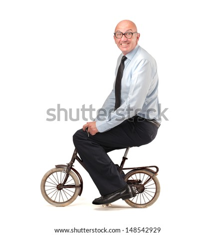 businessman cycling with a small bike - stock photo