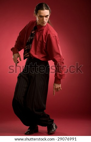 Businessman dance on red background - stock photo