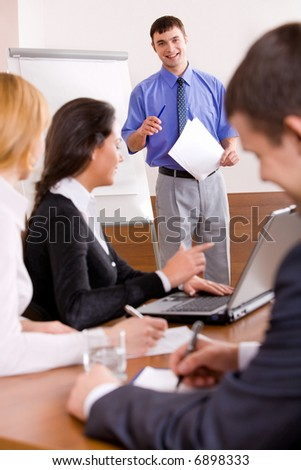 Businessman delivers oneself of a speech in the conference room - stock photo