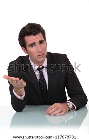Businessman demanding an explanation - stock photo