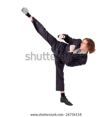 businessman demonstrates a high kick against isolated white background