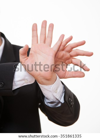Businessman demonstrating prohibiting of a gesture, white background - stock photo