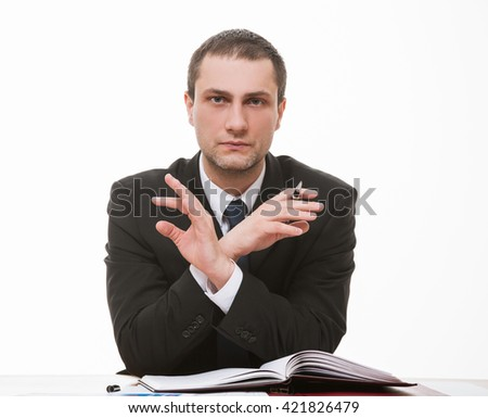Businessman demonstrating prohibiting of a gesture, white background