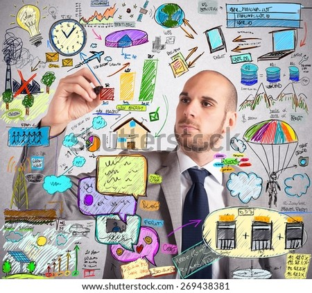 Businessman design an ingenious ecological improvement plan - stock photo