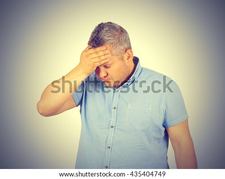 Businessman desperate, depressed, headache. Isolated on background.  - stock photo