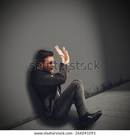 Businessman destroyed afraid and guilty of fraud - stock photo