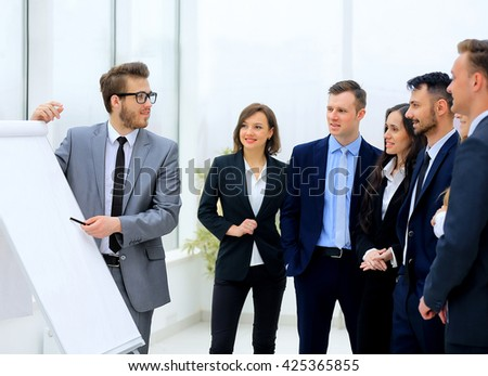 businessman discussing a new business project with the members of his team - stock photo
