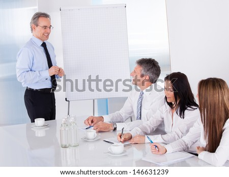 Businessman Discussing New Project With Colleagues In Office - stock photo