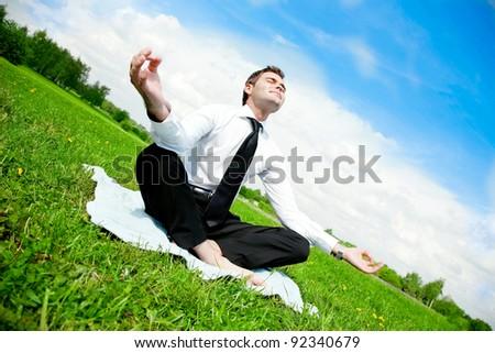 businessman do yoga exercise outdoor - stock photo