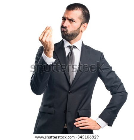 Businessman doing a money gesture