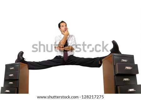 Businessman doing splits over cabinet files