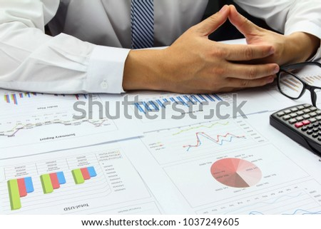 Businessman doing Summary report order plan finance with calculate about cost and worry at table office office.