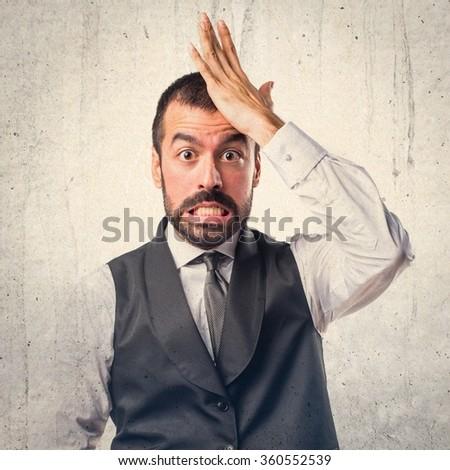 Businessman doing surprise gesture - stock photo