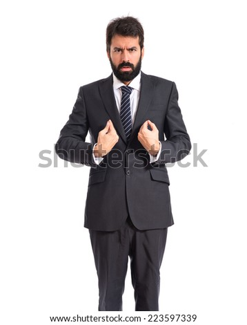Businessman doing surprise gesture over white background - stock photo