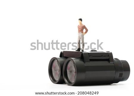 Businessman doll stand on top of binoculars in cocept show vision