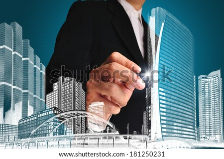 Businessman  draw a  drawing of  building or architect - stock photo