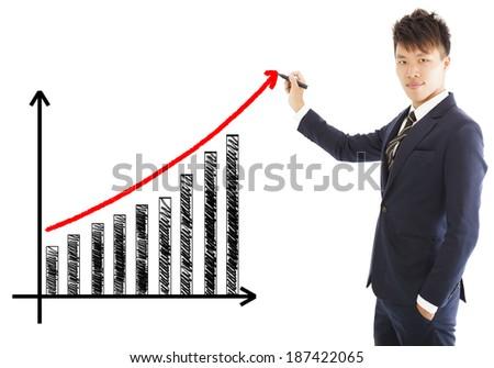 businessman draw a marketing growth chart - stock photo