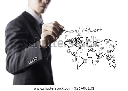 Businessman Draw World Map and Network Icon On Transparent Screen - stock photo
