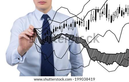 Businessman drawibg the graph.  - stock photo