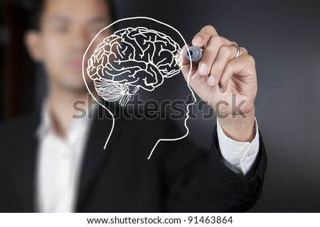 Businessman drawing a brain - stock photo