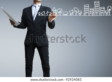 businessman drawing a building - stock photo