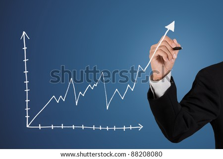 businessman drawing a business graph - stock photo