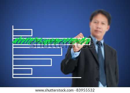 Businessman drawing a chart - stock photo