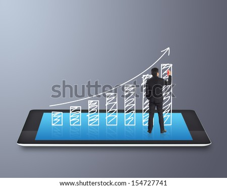 Businessman drawing a chart on touch screen tablet - stock photo