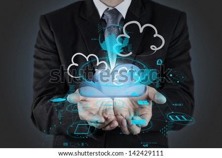 Businessman drawing a Cloud Computing diagram on the new computer interface - stock photo