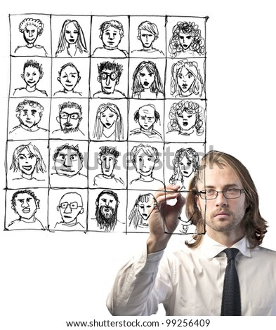 Businessman drawing a composition of portraits - stock photo
