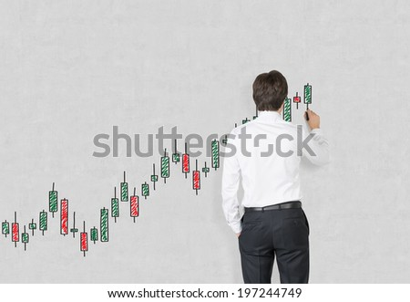 Businessman drawing a graph - stock photo