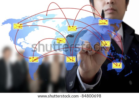 Businessman drawing a graph on the board - stock photo