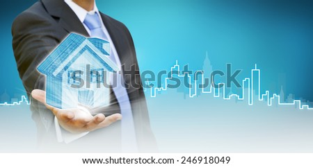 Businessman drawing a house with her finger on a tactile screen