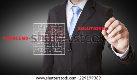 Businessman drawing a maze on a digital screen - stock photo