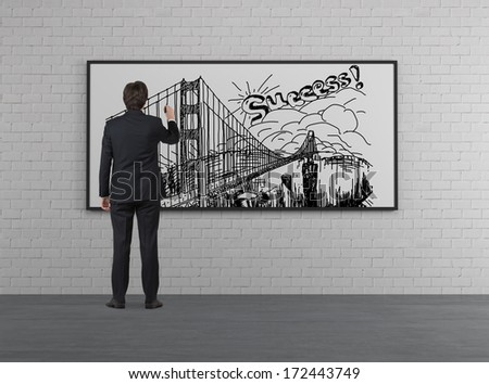 Businessman drawing a picture of success - stock photo