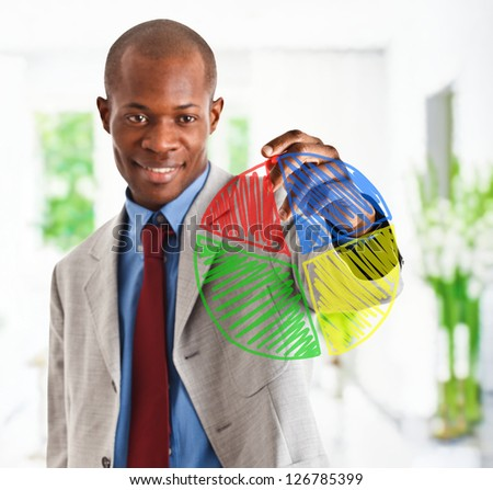 Businessman drawing a pie chart - stock photo